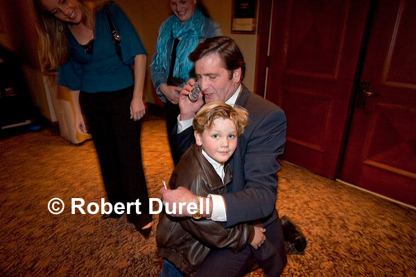 GRANDPA --- John Garamendi decided that the noisy hotel ballroom of the Democratic election night party was not the best place to take a congratulatory cellphone call on his victory as the state's new lieutenant governor. Instead, he took the call out in the hallway, holding his grandson close. This seemed a perfect visual intersection between Garamendis personal and political life.